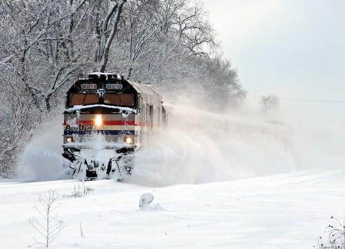 Amtrak Wolverine Train 351 bursts through the snow